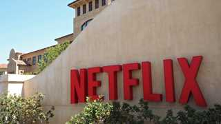 Netflix jumps over 12%, IBM falls after earnings reports