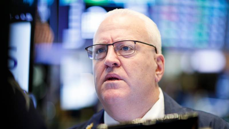 Wall Street closes mostly lower after Fed holds rates