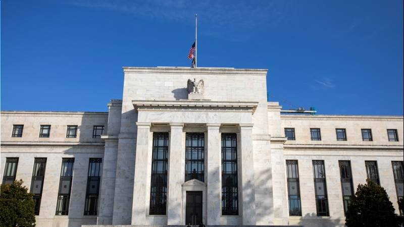Fed holds interest rates, signals further hikes ahead