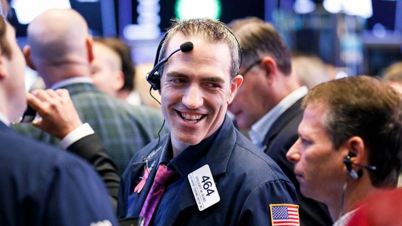 US markets seen lower after Fed hints at future rate hikes