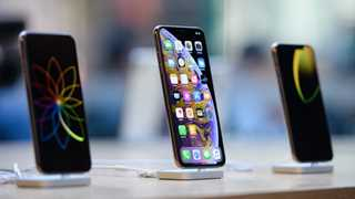 Apple cuts orders for new iPhone models - report