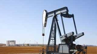Oil prices dip as OPEC awaits Russia to join cut