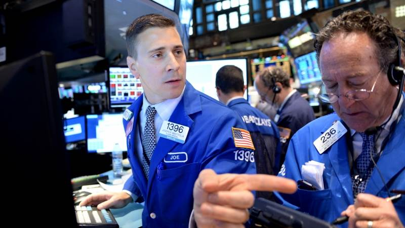 Wall Street opens lower amid jobs report, OPEC meeting