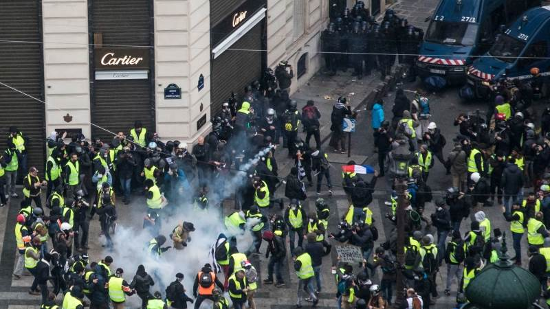 Police, protesters clash in Paris, over 200 arrested