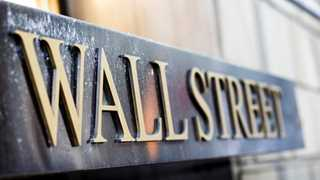 Wall Street closes mixed in another volatile session