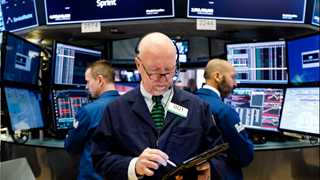 US markets close mixed after Trump's threat to GM