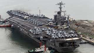 Iran warns US warship to avoid its territorial waters