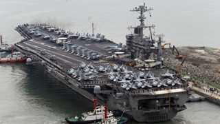 Iran warns US warship to avoid its territorial waters