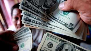 Dollar weakens as Wall Street suffers losses