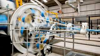 UK factories boost activity to half-year high