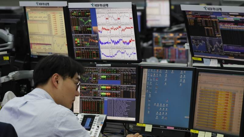 Asian markets mostly higher as China, US talks continue