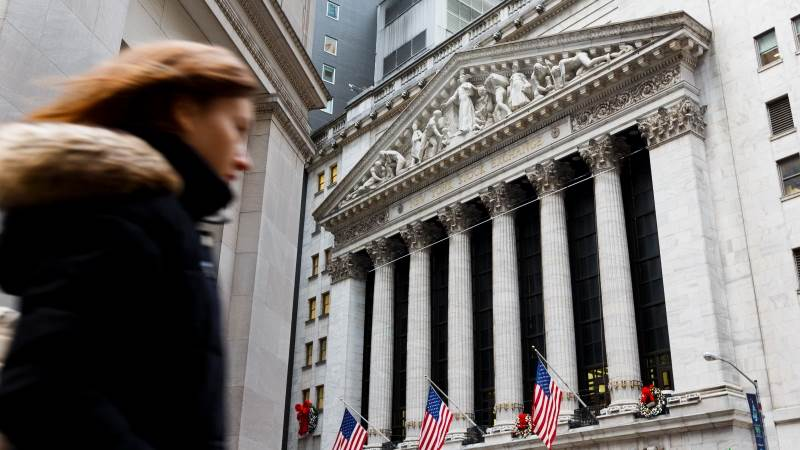 Wall Street closes mostly flat as shutdown nears record