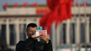 China lifts foreign investment quota by 100%