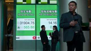 Stocks in Asia mixed as BoJ holds rates