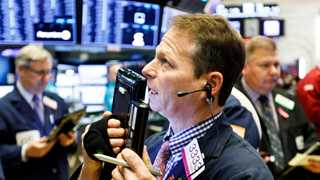 Dow erases gains, Wall Street trades with losses