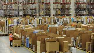 FedEx, UPS drop on Amazon's fee cut plans