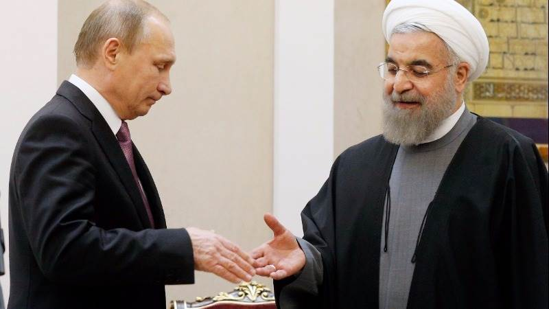 Russia, Iran to cooperate on output freeze, crude up