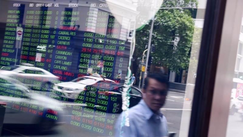 Asian stocks mixed as dollar continues rally