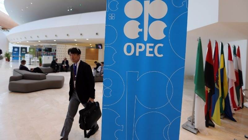 Crude extends OPEC deal rally as dollar edges lower