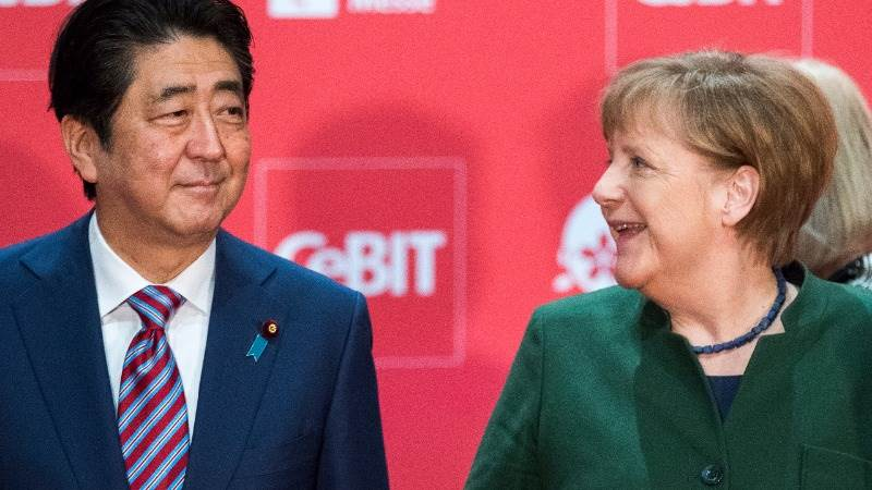 Abe: Japan, Germany should champion free trade