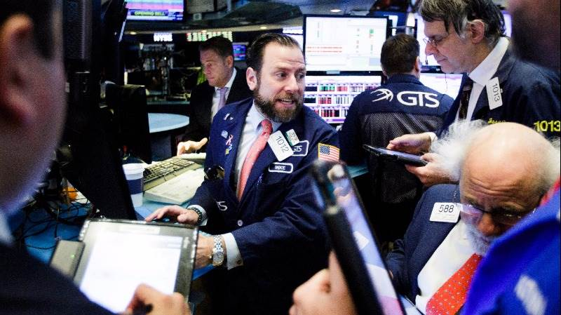 Wall Street opens higher as earnings come in