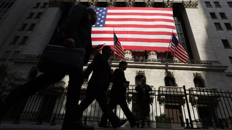 Wall Street closes lower ahead of French election