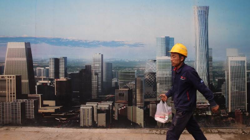 Fitch sees China's growth below government's target