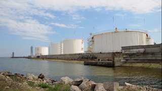 Oil gains as US crude supplies drop