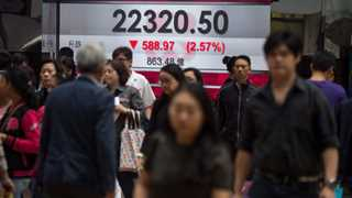 Asian markets mixed after Senate passes budget