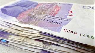 Pound trades higher on UK inflation data