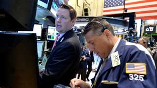 Wall Street closes mostly lower amid possible govt shutdown