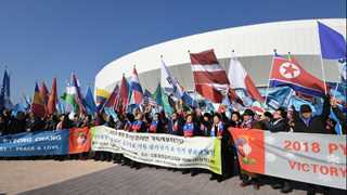 Two Koreas agree to march under same flag at Olympics