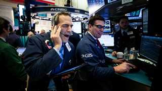 Wall Street opens mostly flat on earnings, data