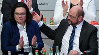 Germany's SPD backs coalition talks with Merkel