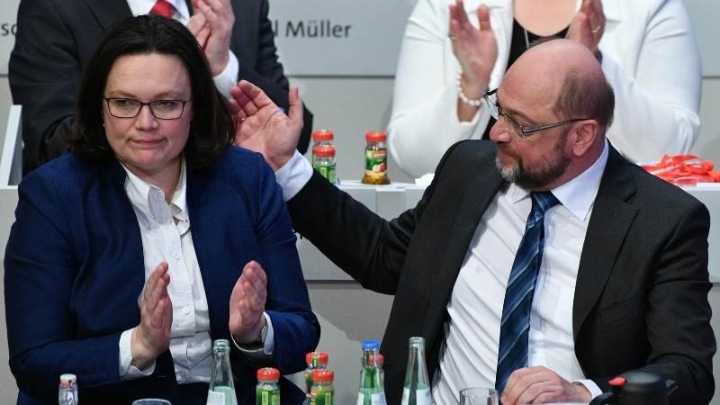 Germany's SPD backs coalition talks with Merkel