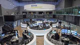 Europe closes flat to higher amid earnings