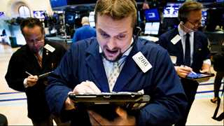 Wall Street closes mixed on earnings reports
