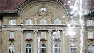 SNB holds rates; Swiss franc is 'highly valued'