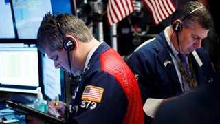 Wall Street closes mixed amid Russia tensions