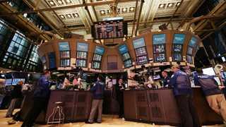 Wall Street closes mixed amid data