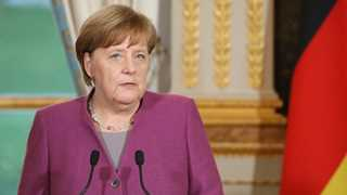 Merkel: German trade surpluses are shrinking