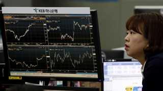 Asian markets trade lower as tech shares slip