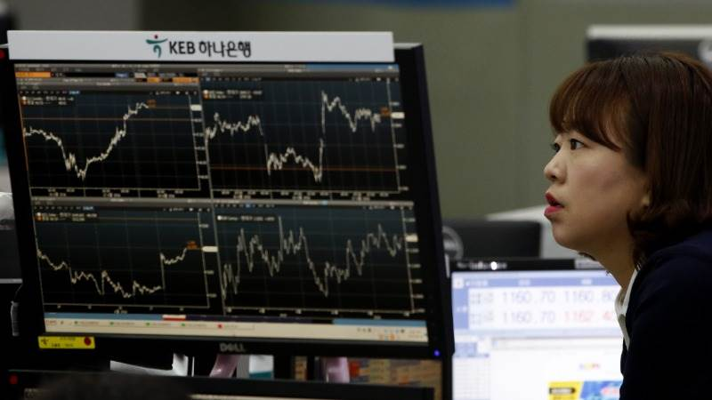 Asian markets trade lower as tech shares slip