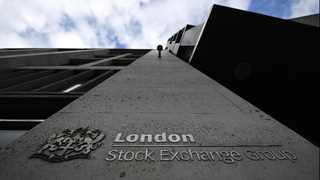 FTSE 100 hits new record on weaker pound