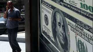 Dollar surges on trade detente with China
