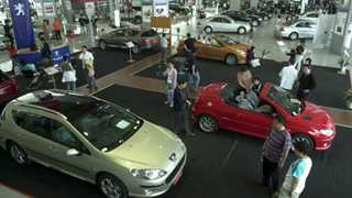 China to cut import tariffs on cars to 15%