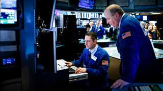 Wall Street closes higher on Fed inflation remarks