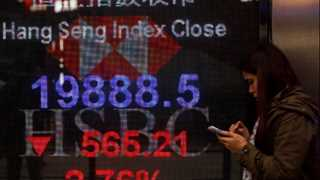 Asian markets mostly slide after Trump-Kim summit recall