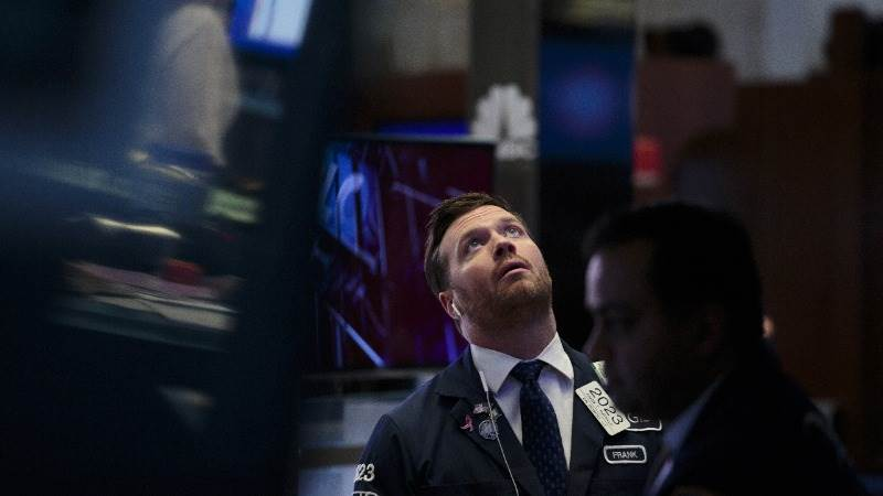US markets open mostly flat ahead of Fed interest rate decision