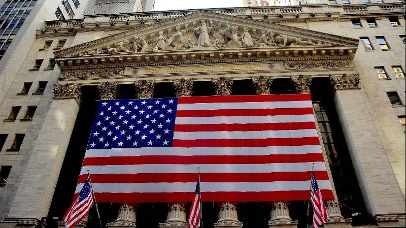 US stocks turn positive on Powell remarks